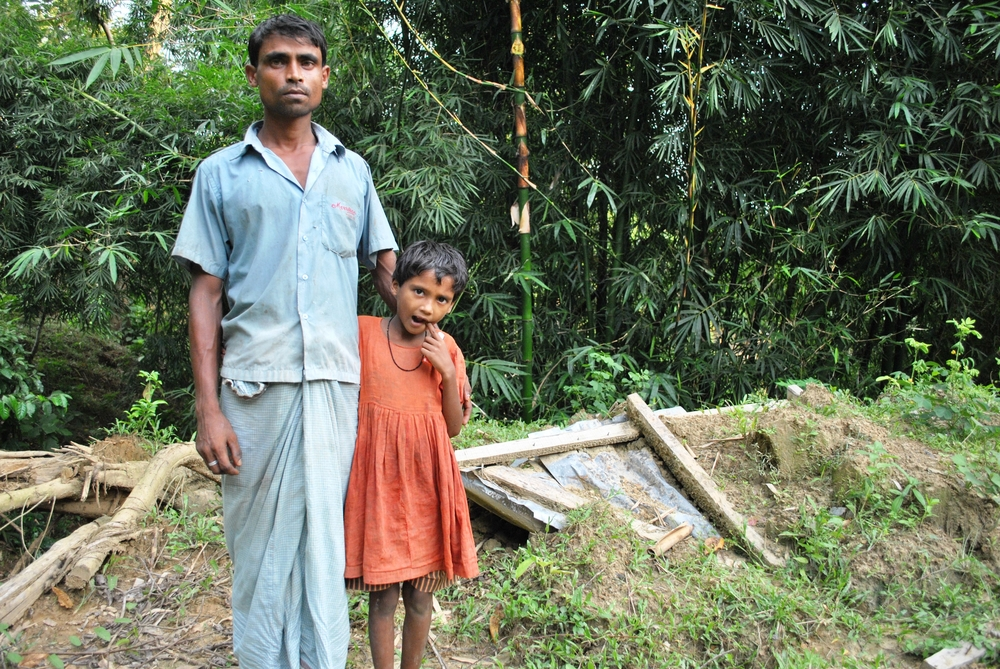 "Bullu Mia, a villager in Ukhia District in southeastern Bangladesh, is rebuilding his home on almost exactly the same spot where a landslide buried alive his wife and son in June 2012. ""Where else would I go,"" he said"