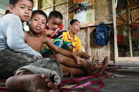 Displaced children join their grandmother in a temporary sheltering area in the southern Philippine town of Datu Piang. Tens of thousands of people have been displaced by the conflict