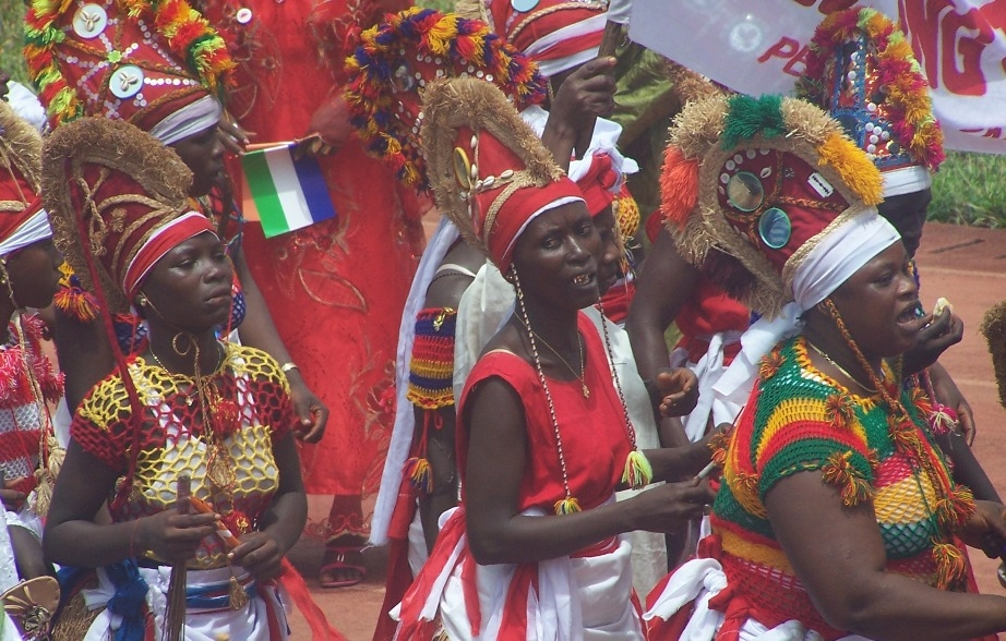 Soweis and Bondo dancers dance in Freetown on Independence Day, 2012. These are members of the Sande or Bondo society, who traditionally lead girls into their initiation into womanhood. Soweis are prominent leaders in these socities