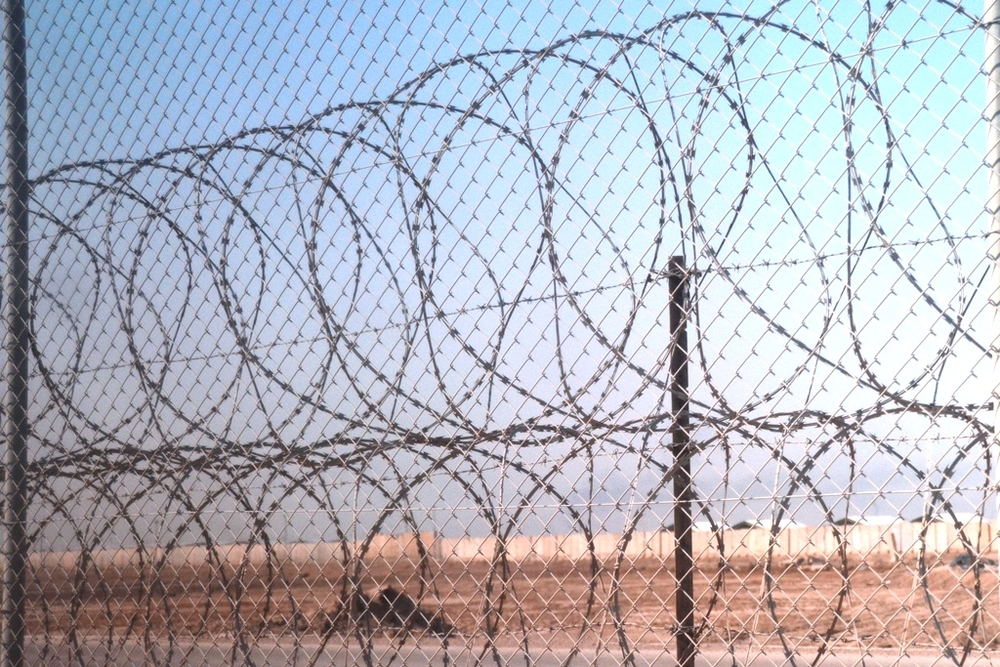 A barbed wire fence at the entrance to a former US compound (now used by the UN) in Basra, southern Iraq