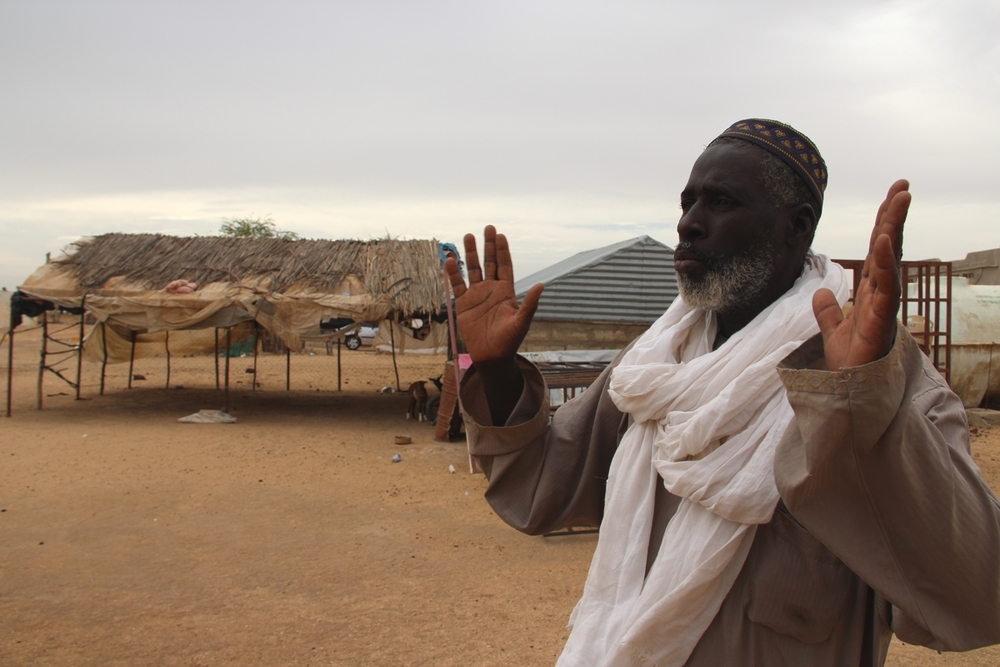 Aliou Moussa So, head of a refugee community of 73 families in PK 6 village, 6km from Rosso, shows IRIN his village. Many families live in metal hangars provided by UNHCR, a few in brick-built one-room homes