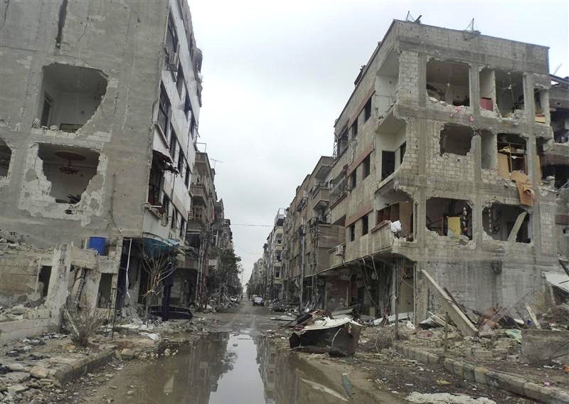 Buildings damaged after shelling by forces loyal to Syria's President Bashar al-Assad are seen at Douma near Damascus November 19, 2012