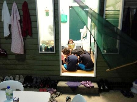 A group of children study in a container without doors at the Manus Island offshore processing facility. Many of the detainees are from Sri Lanka