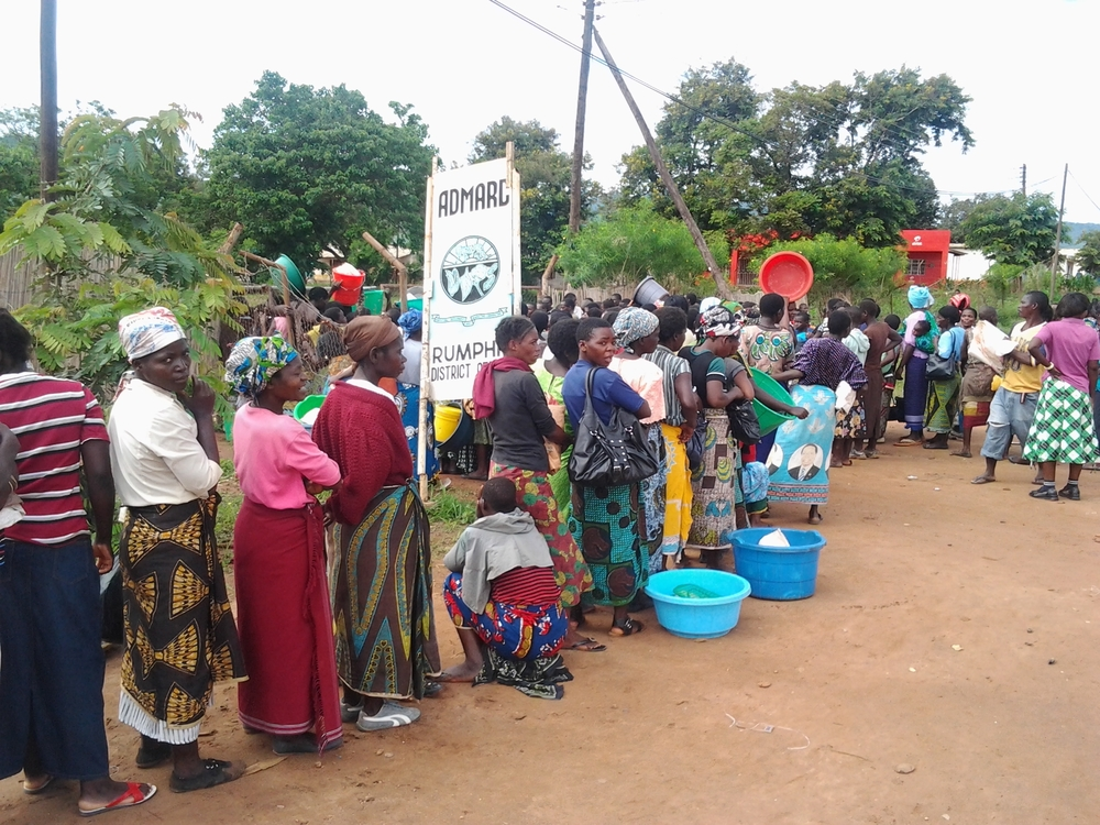 Consumers line up to buy scarce maize supplies at a market in Rumphi, northern Malawi