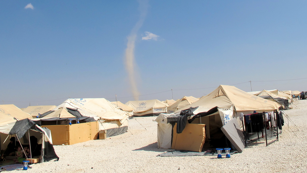 A whirlwhind approaches Za'atari camp for Syrian refugees in the northern Jordanian desert. Poor protection from the elements has led to riots in the camp