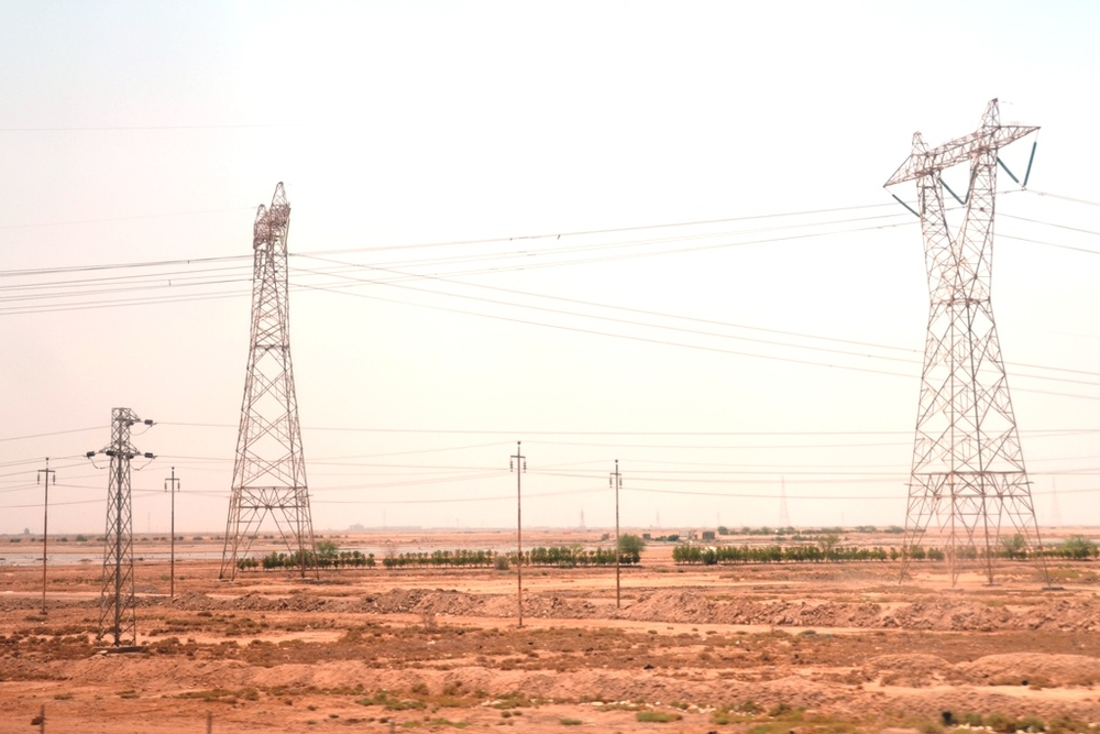 Electrical towers in Basra, southern Iraq. Iraqis receive on average 8 hours of electricity from the public grid a day and many depend on private generators
