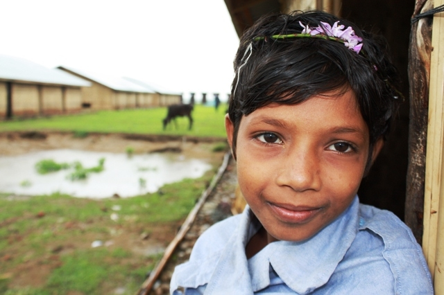 A young Rohingya girl looks to the camera at an IDP camp outside Sittwe in Myanmar's western Rakhine State. An estimated 140,000 people were displaced, mostly Muslim Rohingya, following two bouts of deadly sectarian violence in 2012
