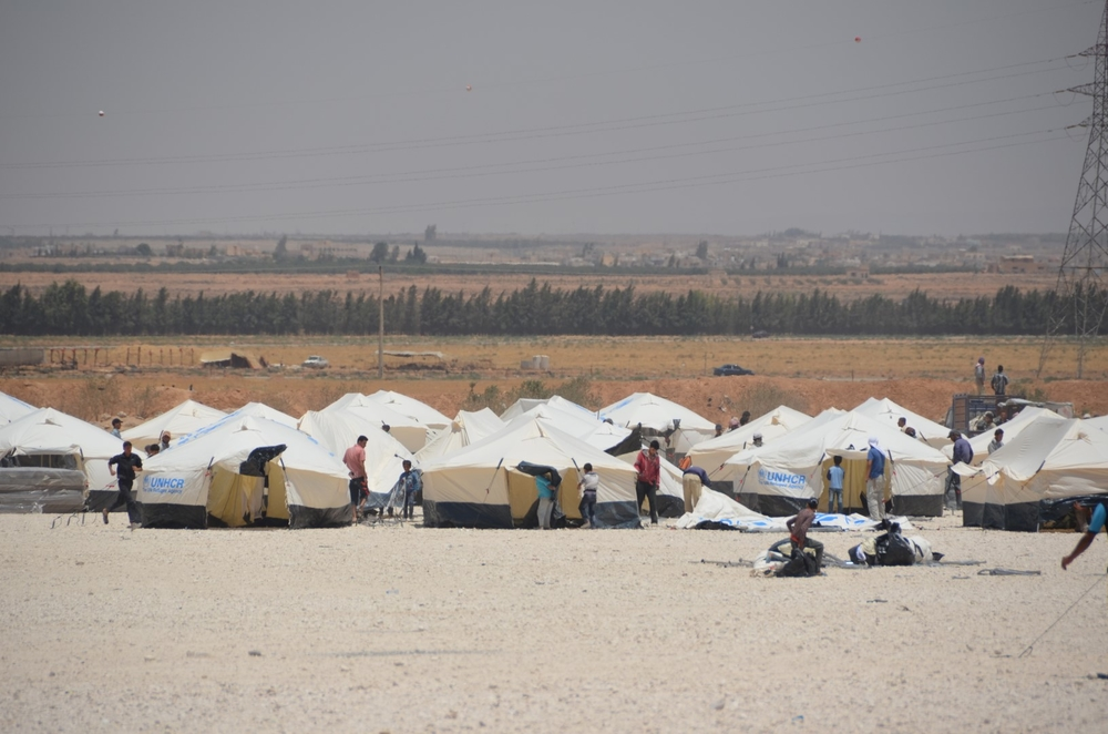 New arrivals set up their tents at Za'atari camp for Syrian refugees in northern Jordan. The camp is home to some 120,000 people who live in harsh desert conditions