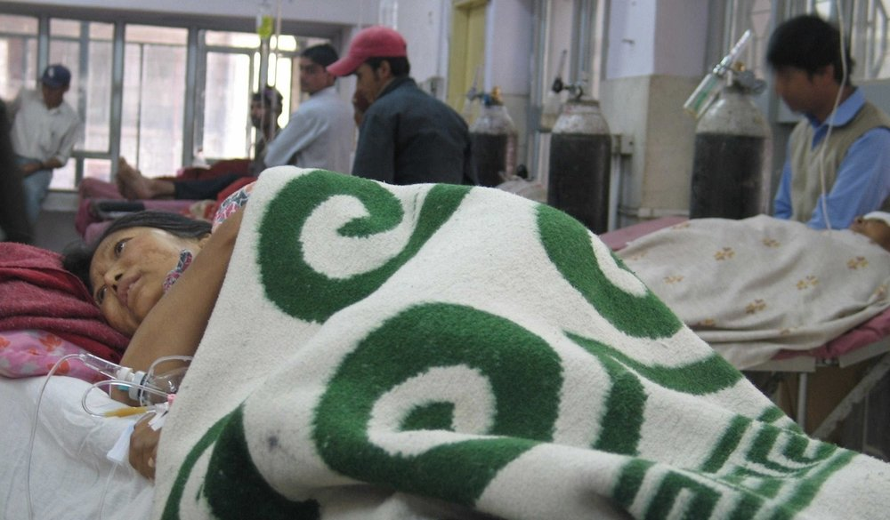 A patient lies in Bir Hospital in Nepal