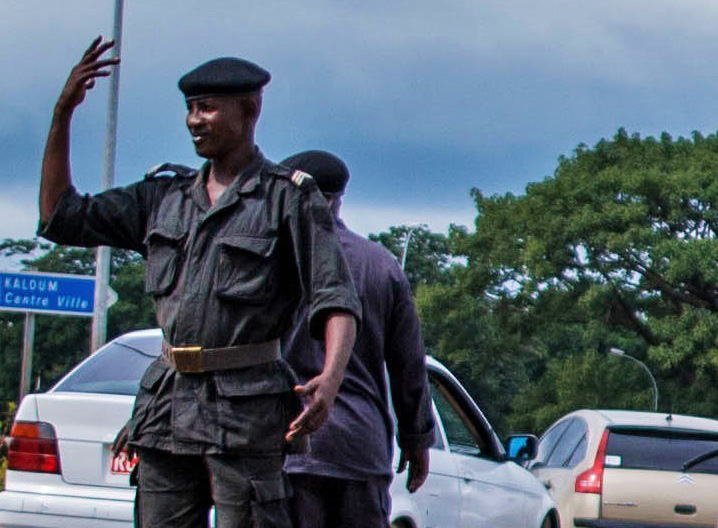 Police directing traffic at a Conakry roundabout.