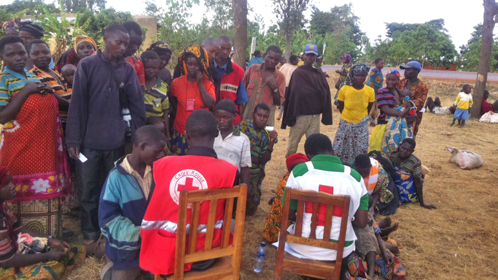 Returnees get registered by the Red cross at Rugari on September 13, 2013