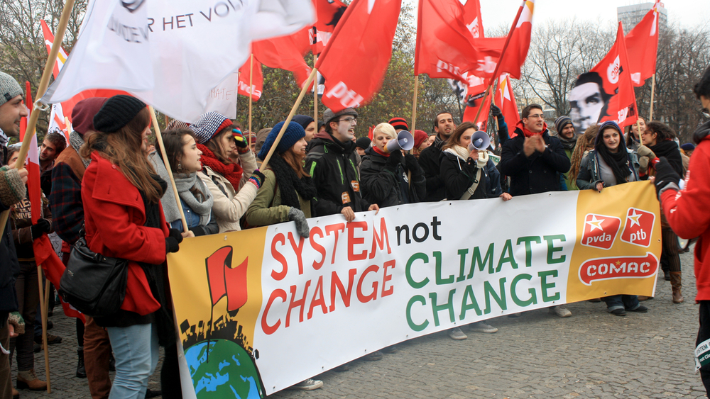 Activists march for climate and social justice in Warsaw's streets urging action at the UN climate talks being held there