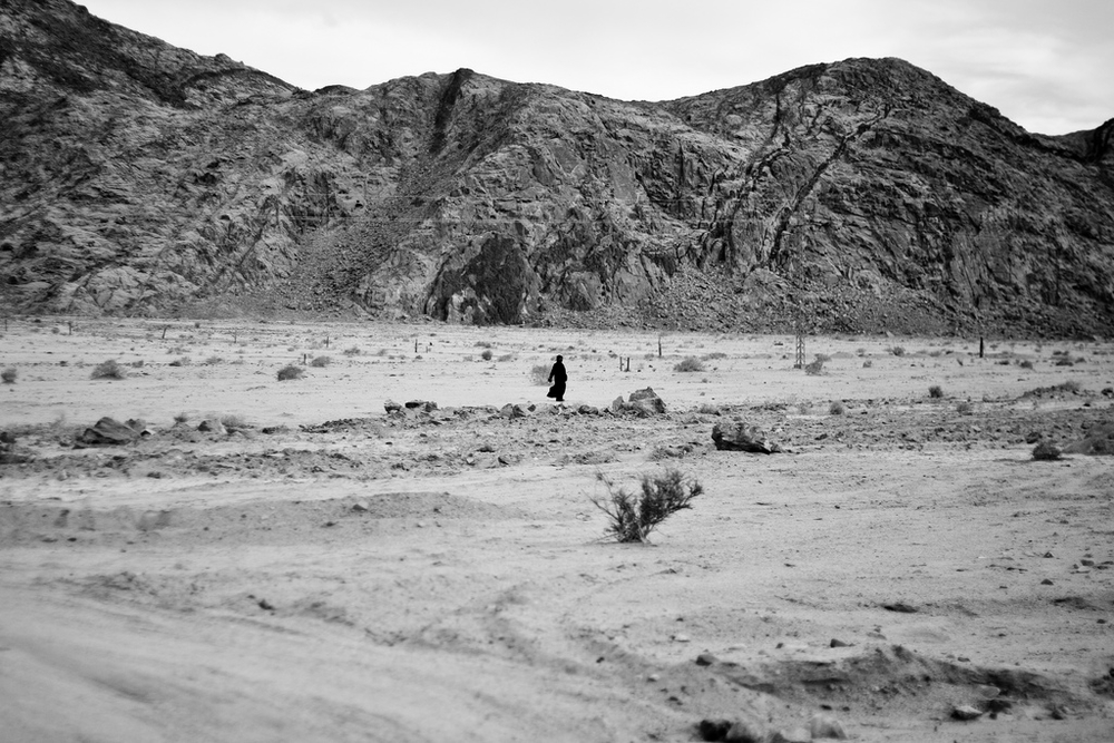 A Bedouin man walks through the desert in South Sinai, Egypt.