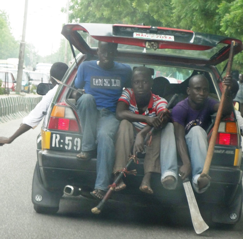 Members of a civilian joint task force in Maiduguri in November 2013. CJTFs have been set up all over the city to identify and turn in Boko Haram suspects but some have beaten up or killed suspects themselves, and people say the CJTF's actions are making