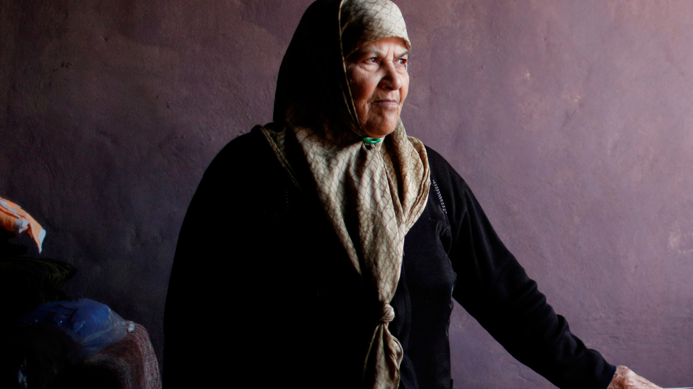 Nasr Ali mohammad, 69, stands in the kitchen of her home in a Palestinian settlement in Qasrmiyeh, near Tyre in Lebanon, on December 20, 2013. Nasr has lived here for 40 years but due to Lebanese law has no secuity of tenure