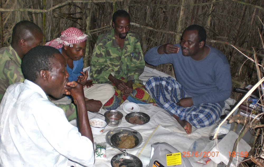 Jamil Mukulu, the ADF leader and his top commander in the bush camp in thier camp in eastern DRC (file photo)