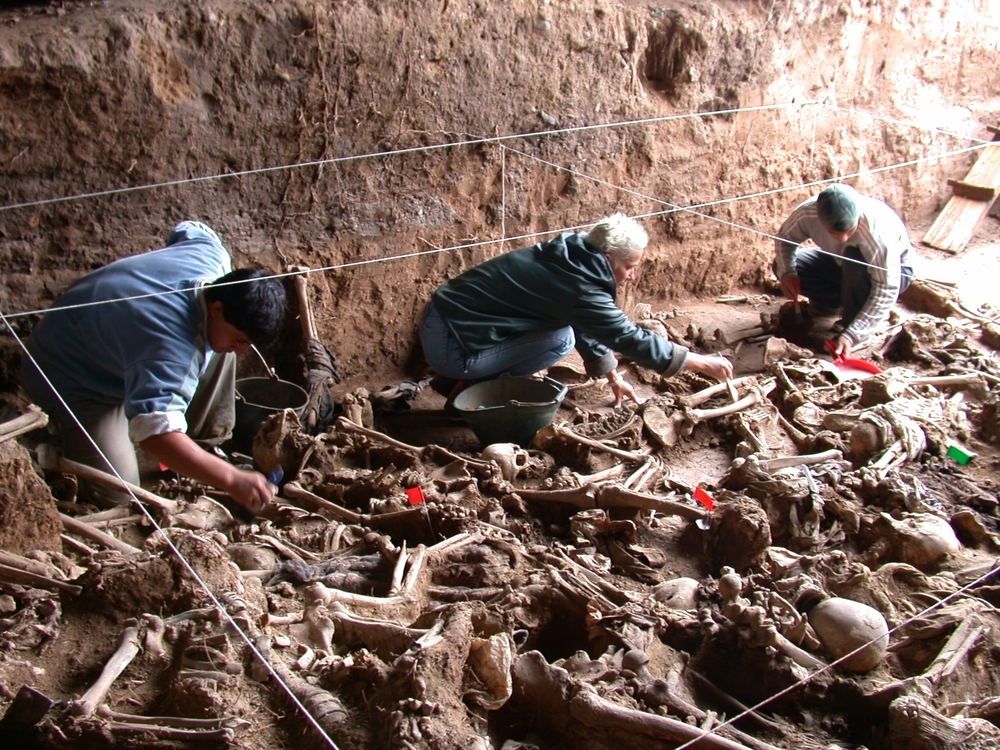 Members of the Argentine Forensic Anthropology Team sift through remains in search of persons who disappeared during the country's Dirty War