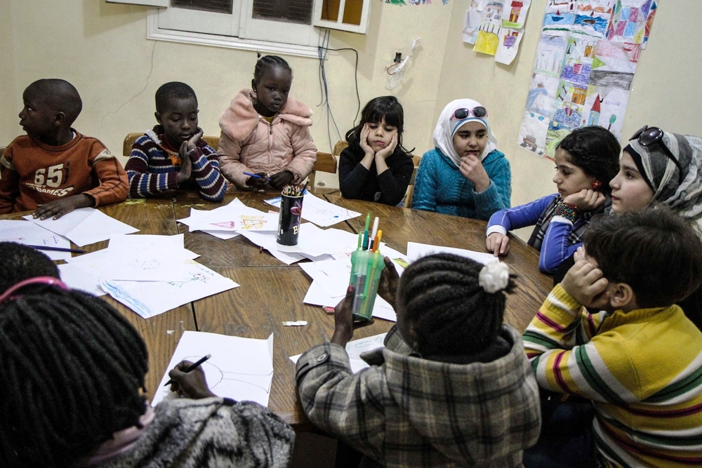 Syrian, Sudanese and Somali children at an art class offered by Egyptian NGO Tadamon. Refugees in Egypt are increasingly struggling to access education through the public system.