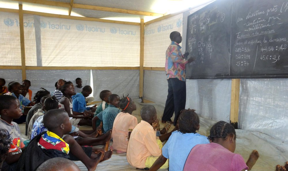A class at one of Unicef's temporary learning spaces in Bangui - at Boy Rabe monastery site.