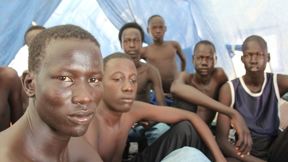 Nuer youths from South Sudan in a tent on the site for new arrivals at Kenya's Kakuma Refugee Camp