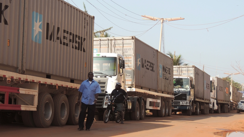 Trucks parked on Amílcar Cabral Avenue in Guinea-Bissau's capital awaiting to offload wood that environmental activists say has been illegally harvested in the country's forests
