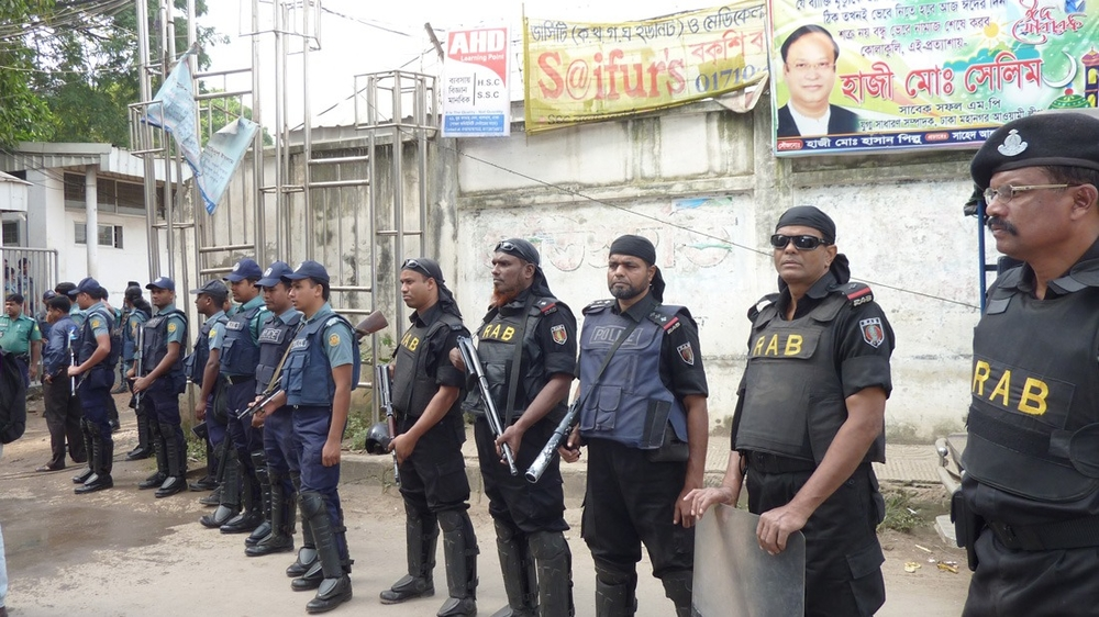 Members of Bangladesh's Rapid Action Battalion (RAB), a controversial police force, await a verdict on a Bangladesh Border Guard mutiny case in Dhaka.