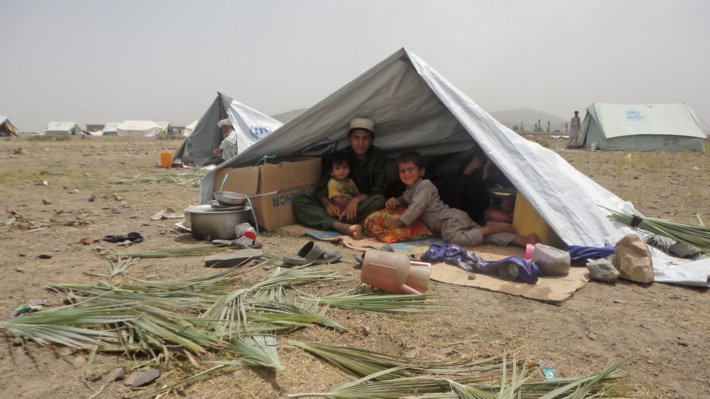 A family from Miramshah, North Waziristan inside a tent in Khost, Afghanistan.
