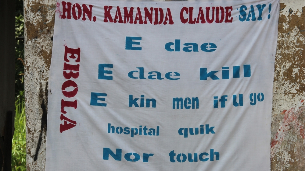 Sign in Kriol urging people with Ebola symptoms to go to a clinic.