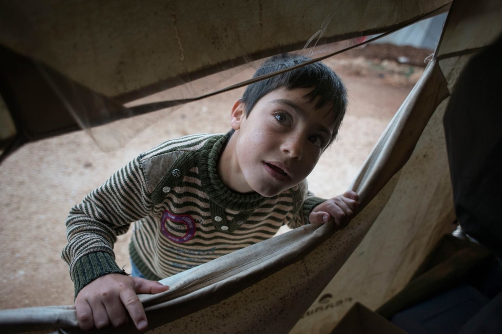 A young Syrian boy living in a tent in Marj El Khokh camp, an informal tented settlement for Syria refugees in Marjayoun area, Lebanon.