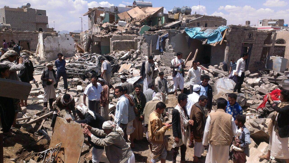 Yemenis in the Bani Hewat district of the capital Sana'a search for survivors under the rubble after Saudi Arabian planes bombed the area on March 26, 2015