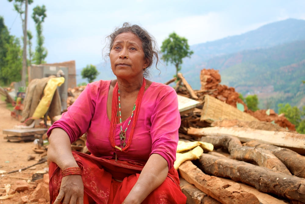 Rita Rai, 50 years old, sitting near her totally destroyed home in Banghar village, Nepal. A 7.8 magnitude earthquake struck Nepal 25 April, 2015. Aid agencies faced severe challenges trying to reach remote villages.