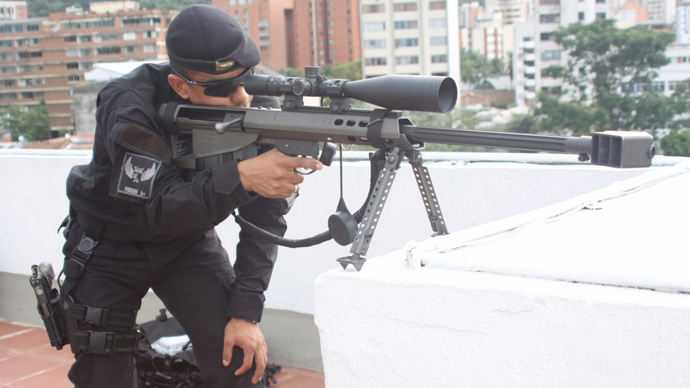 Policeman in Colombia with rifle