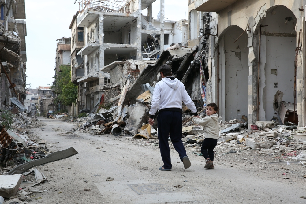In Syria, two generations of Homs residents attempt to rebuild their lives among the ruins.