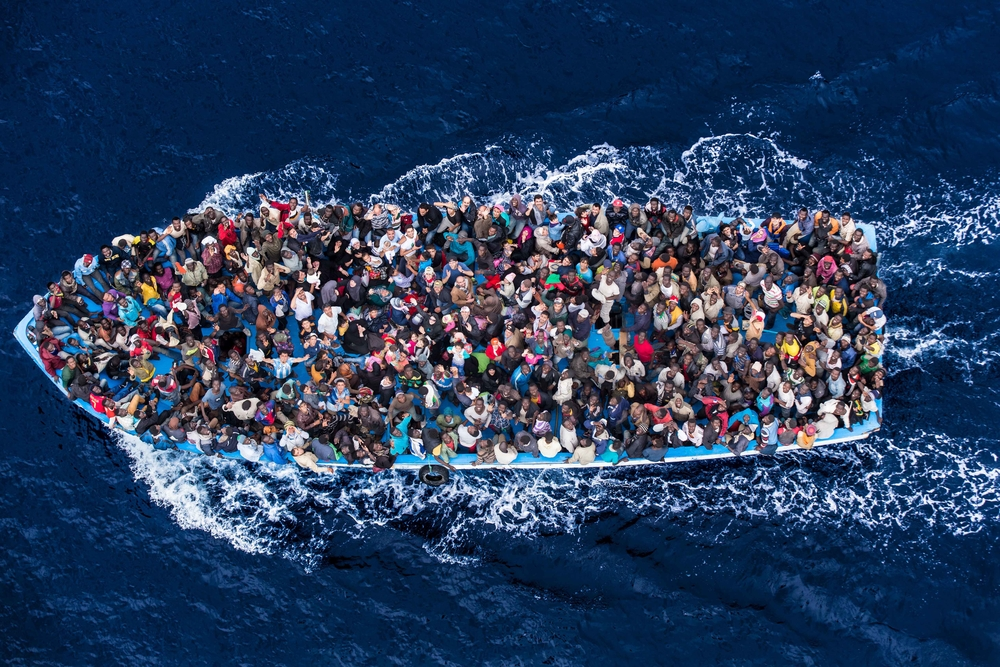 Hundreds of refugees and migrants crossing the Mediterranean aboard a fishing boat, moments before being rescued by the Italian Navy as part of their Mare Nostrum operation in June 2014.