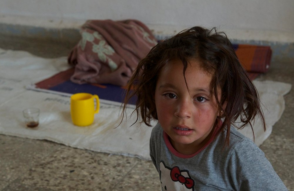 A child from the Hassakeh region of northern Syria displaced by the advance of militants from the Islamic State in June 2015