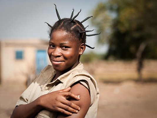 Edwinge Nana, 19, after vaccination in the village of Koubri. Edwinge's little brother Charles died of meningitis at age 7.