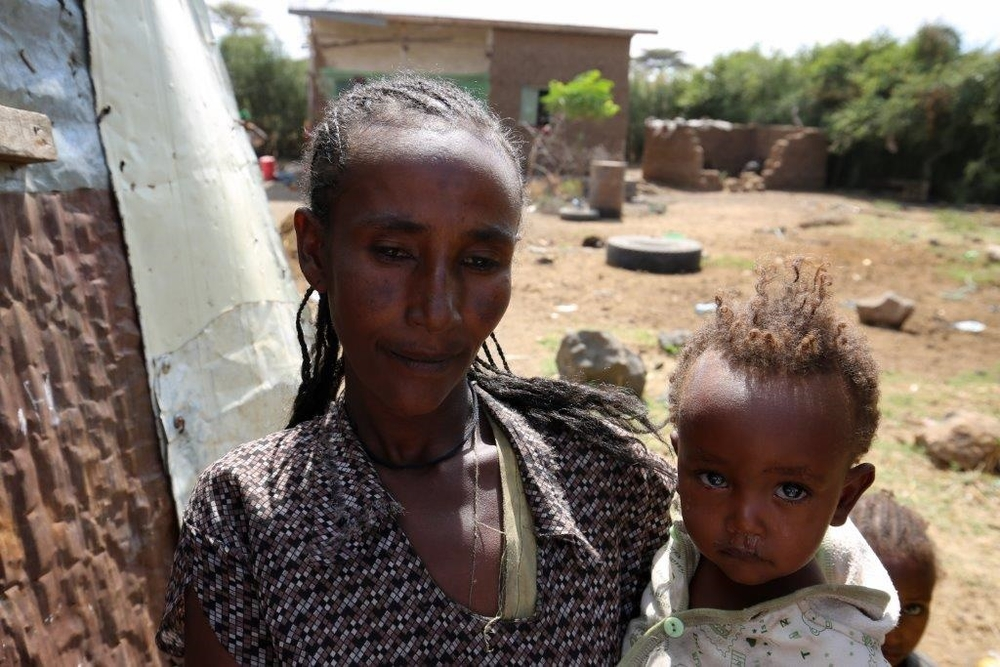Workitu Tegenu and her children at their home near the town of welenchiti, Ethiopia, about 120km southeast of the capital Addis Ababa. Photo: Colin Cosier. Date: 19 November 2015.