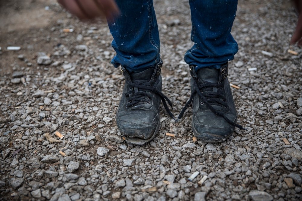 An Afghan man's broken boots, after traveling through Iran, Turkey and Bulgaria and arriving in Serbia