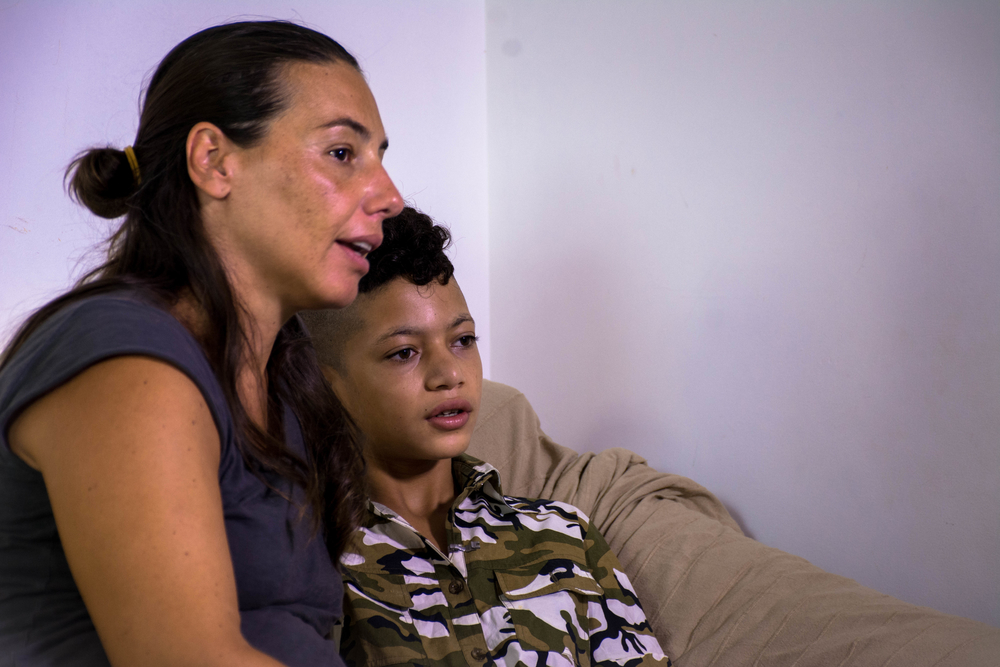 Carla Trommino, founder of the Sicilian NGO AccoglieRete with Taha, one of the 20 unaccompanied migrant children she has fostered in the last three years