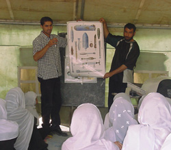 [Afghanistan] Save The Children staff speaking to female students in Kabul on the dangers of landmines and UXO.