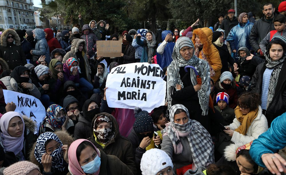 Refugees and migrants demonstrate in the city of Mytilene against living conditions in the Moria camp.