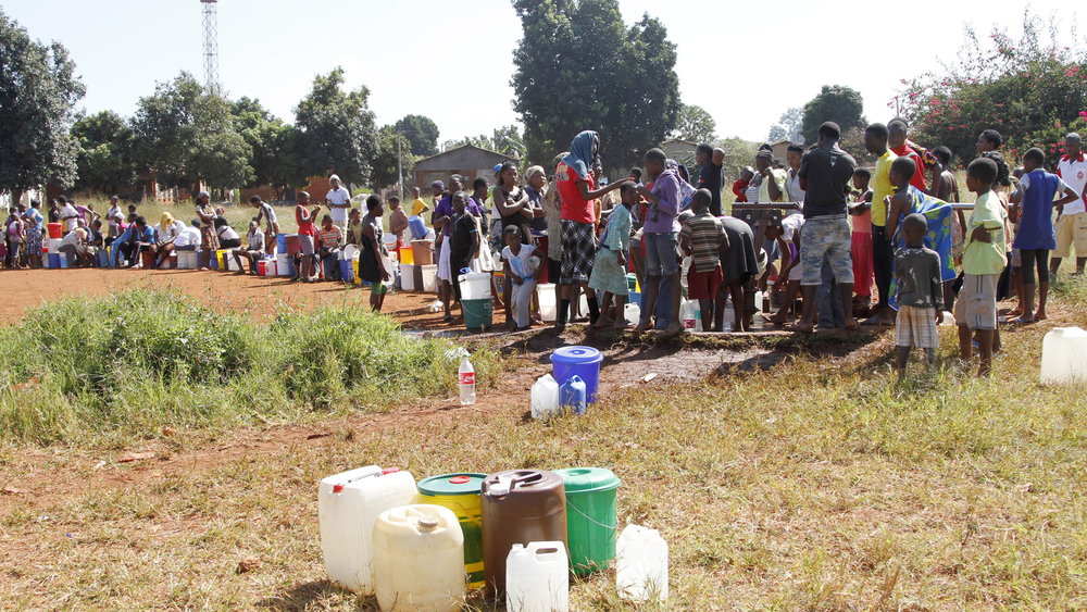 Kuwadzana residents in Harare queue for water at a borehole.