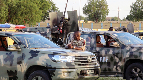 A soldier stands next to a truck to prevent workers from accessing the offices of the Mercy Corps humanitarian group in Maiduguri, in the northeast of the country, on 25 September 2019.