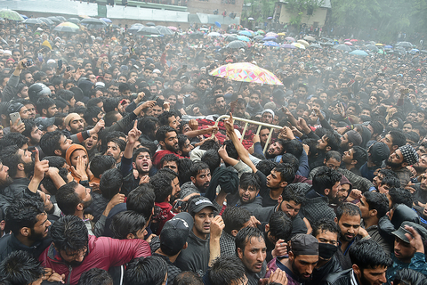 Kashmiri villagers carry a body of top militant commander Zakir Musa of Ansar Ghazwat-ul-Hind group, which claims affiliation with Al-Qaeda, during a funeral procession at Dadsar village in Tral, south of Srinagar
