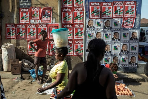 Photo of political posters at a market in Mozambique.
