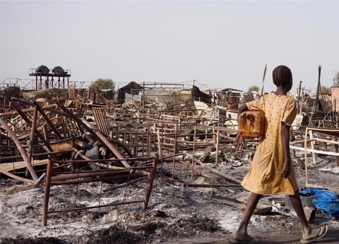 Girl walks through the ruins of Malakal PoC destroyed in fighting
