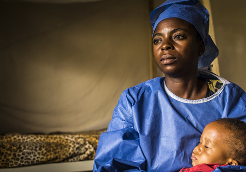Photo of a child and caregiver in an Ebola treatment centre in Congo