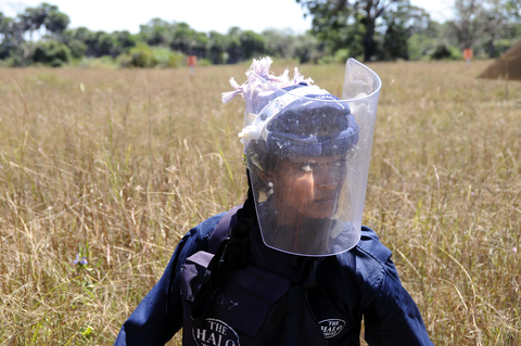 Photo of a de-mining technician in Sri Lanka with protective gear