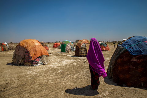 Agan Kadiye 57, walks to her home at a settlement in Hadhwe sub-district has been particularly hard hit by a drought