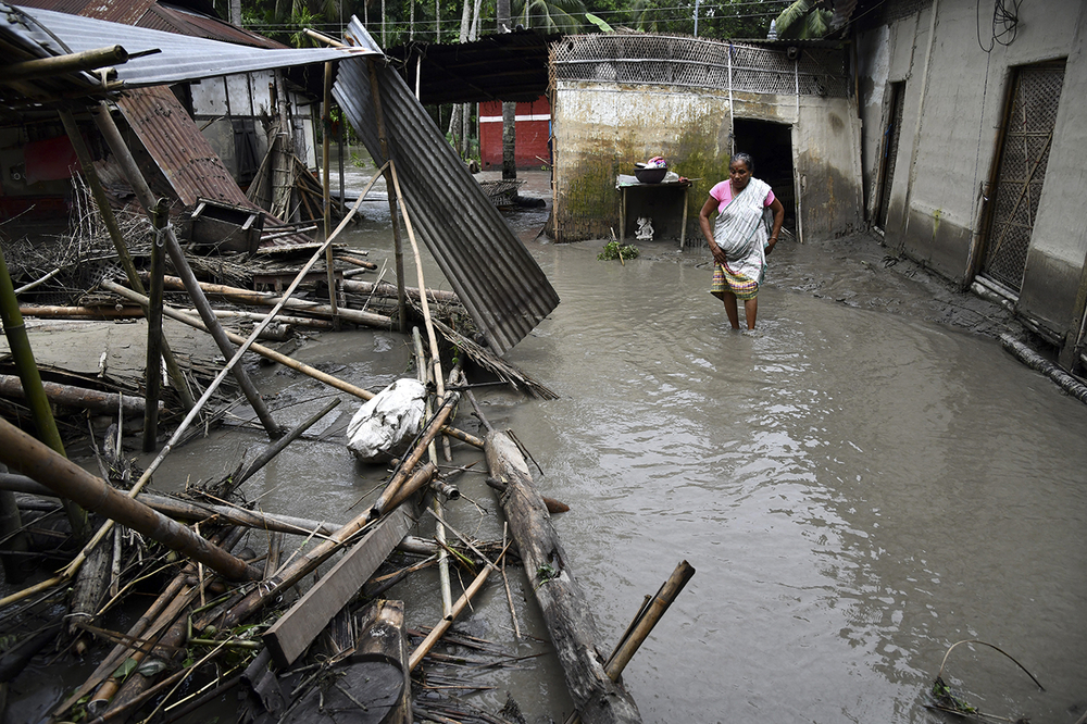 Photo of Indian woman in flood in Assam.